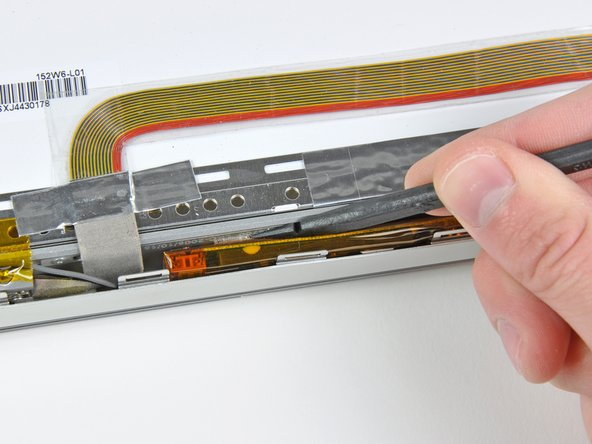 If necessary, use the flat end of a spudger to peel the tape securing both ends of the display inverter to the clutch cover.