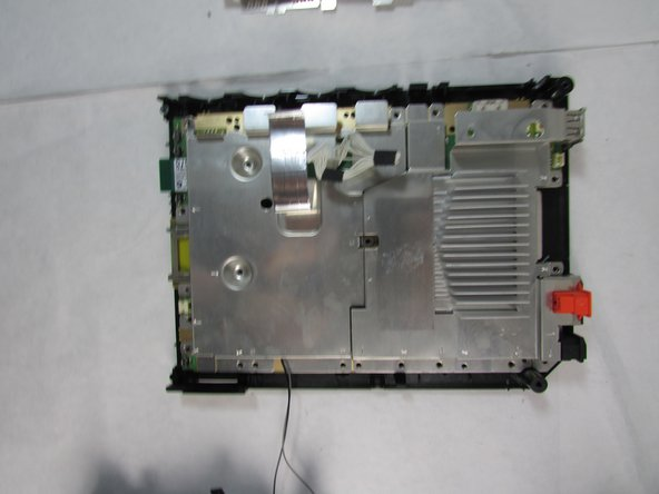 Remove the metal plate covering the motherboard carefully.