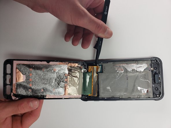 Use the tweezers to disconnect the screen from the phone by detaching the connection.