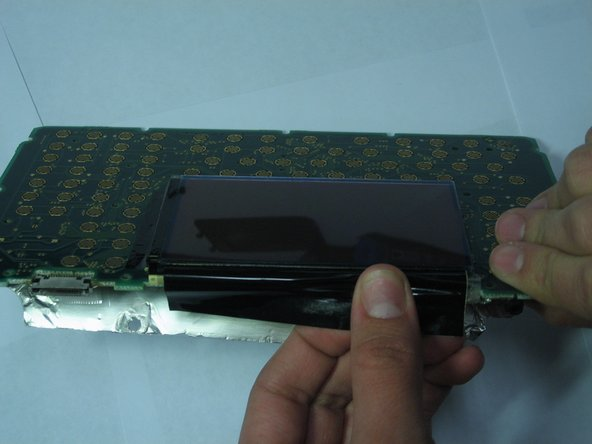 Tilt the calculator up from the front so that you can see the LCD screen