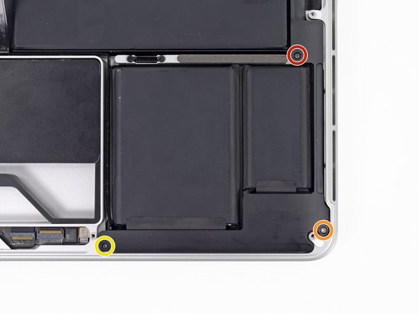 Use a T5 Torx driver to remove the following screws securing the left speaker to the upper case: