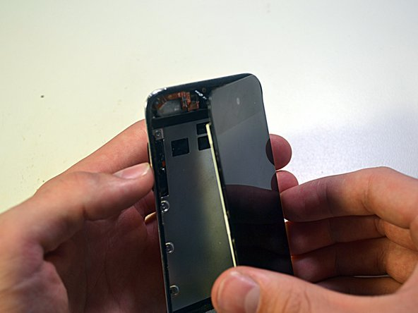 Use extreme caution when handling the front panel assembly, as it is attached to the rest of the Touch by the very delicate digitizer cable.