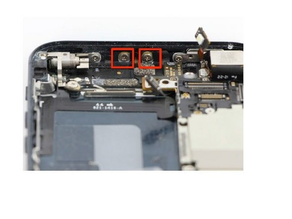 At the top of the frame, remove the two 1.3mm Phillips screws holding the cellular service and GPS antenna's against the frame.