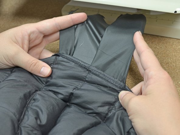 Turn the jacket right-side out again so you can see the original baffle stitching.