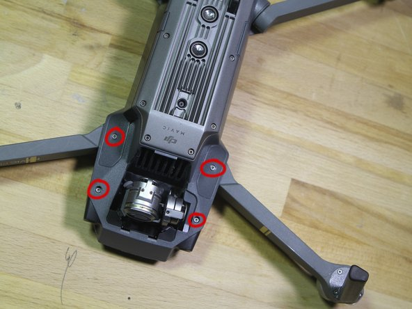 Now, flip over the drone, and orient it with the camera facing you. You should remove the camera/gimbal cover at this point, but its probably a good idea to leave the gimbal brace in place.