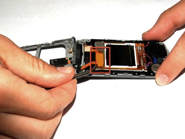 Use the tweezers to lift the display adapter off the screen component.