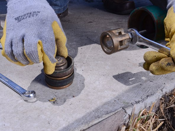 Remove the poppet from the valve to check for signs of wear.
