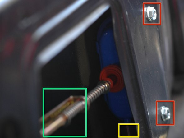 You can now see the trunk actuator. It connects to the lock mechanism by the metal rod with a spring.