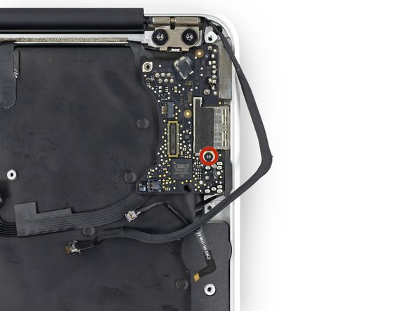 Remove the single 3.6 mm T5 Torx screw securing the I/O board to the upper case.