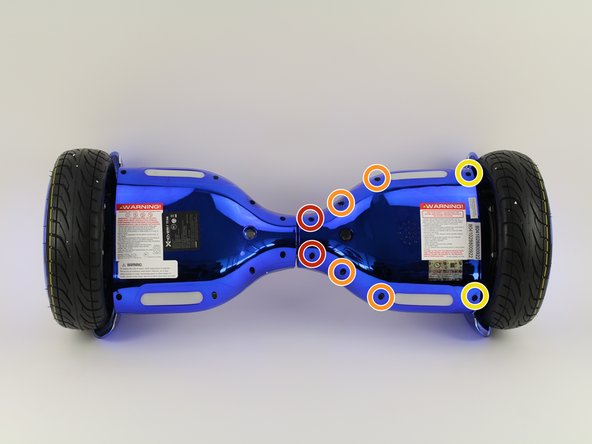 Using a Phillips #1 screwdriver, remove the two 14 mm screws located closest to the center of the hoverboard.