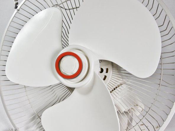 Remove the spinner from the center of the fan blade.