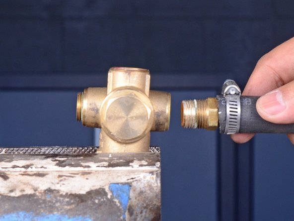 Remove the return hose nipple with the hose attached.