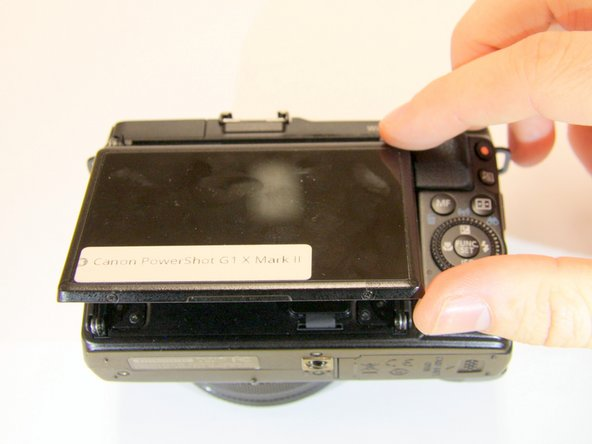 Rotate the LCD screen away from the camera.