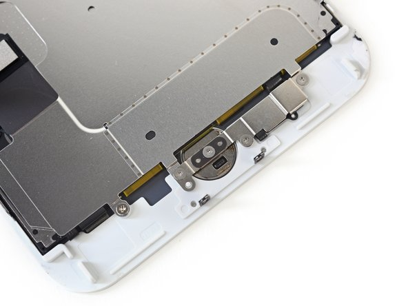 More tri-point screws secure the home button and LCD shield plate.