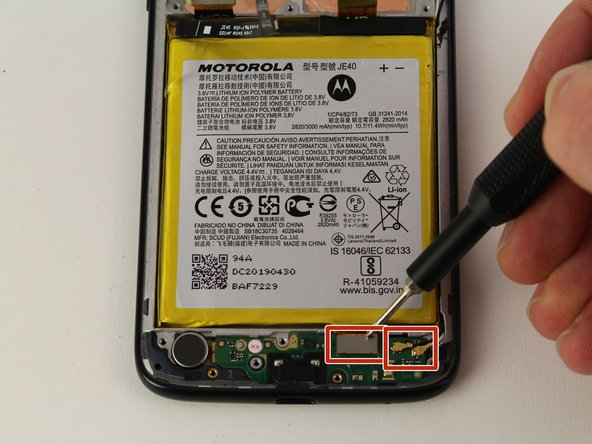Using an iFixit opening tool, detach the cables from the charging port assembly.