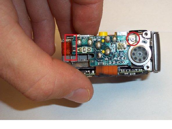 Remove the screw at the upper right corner. (Picture 1)