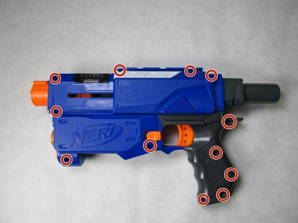 Remove the eleven 8mm  and two 10mm Phillips head screws from the left side of the blaster, and carefully remove the outer casing.