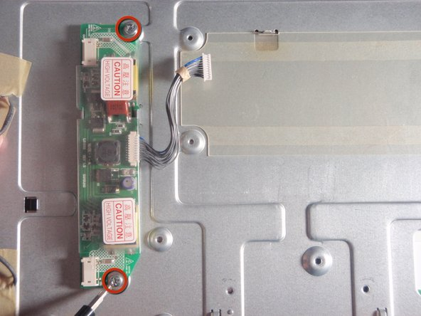 Remove the two screws on the top and bottom of the CCFL inverter with #2 Phillips head screwdriver.