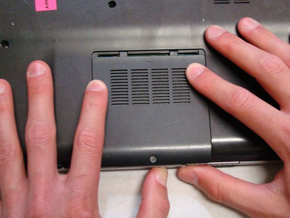 Use your fingers to slide the cover away from the laptop. (It will only slide a few millimeters)