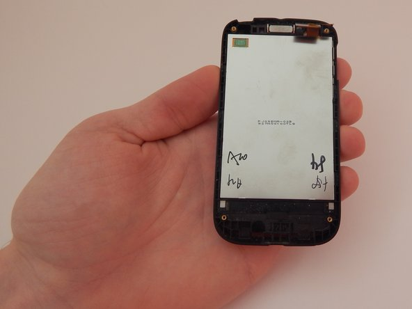 Pick up the front half of your phone with your left hand.