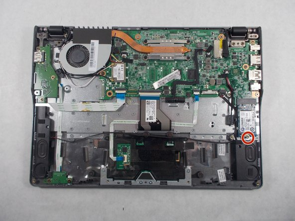 Remove the single 3.0mm screw securing the solid state drive using a Phillips #1 screwdriver.