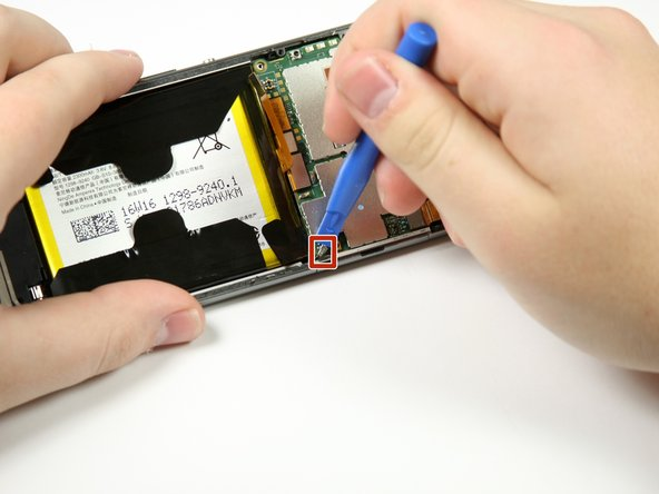 Pop off the small connector on the right side of the motherboard with the plastic opening tool.
