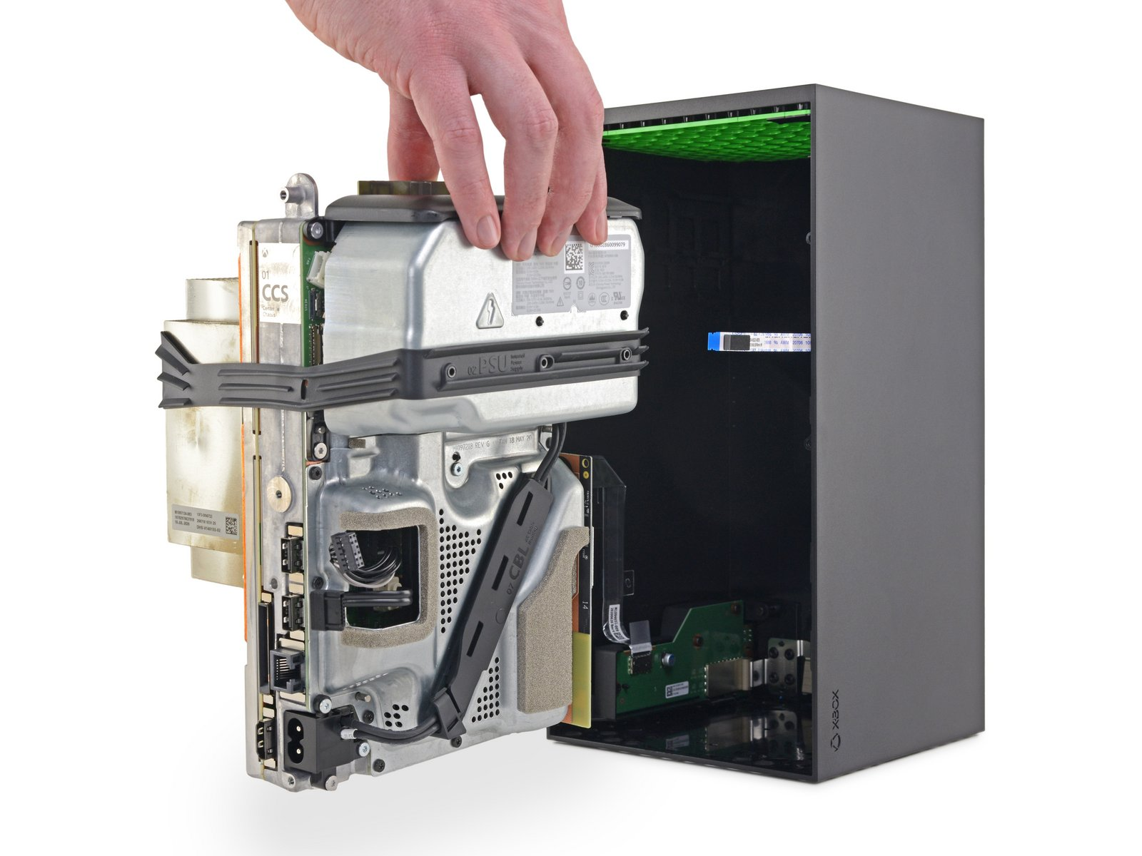 Removing the insides of an Xbox Series X.
