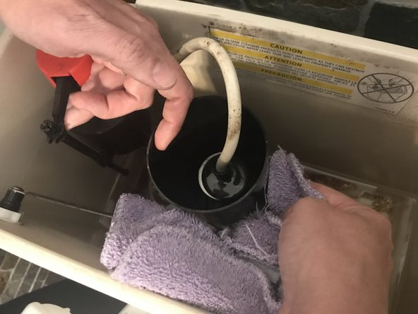 Wipe the valve seat with a rag or towel to remove the calcium deposits. Don't forget to wipe the bottom of the valve seat, as deposits can form there as well.