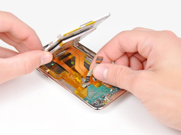 Peel the display data cable off the adhesive securing it to the rear panel.