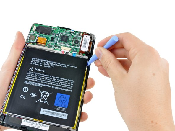 Fit the tip of the plastic opening tool between the right battery cell and the Kindle Fire's frame.