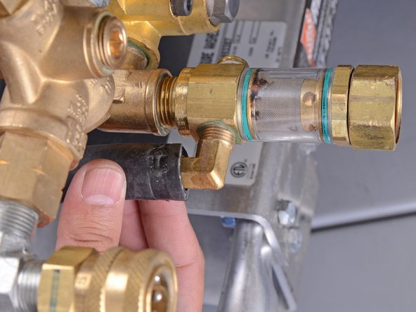 Wiggle the hose and pull it off of the brass nipple.