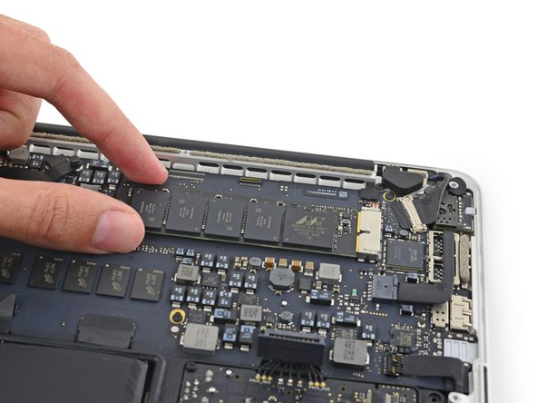 Lift the free end of the SSD up slightly and pull the SSD straight out of its socket on the logic board.