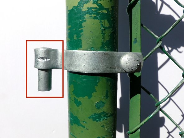 Slide the hinge strap onto the post so that the pin is facing down.