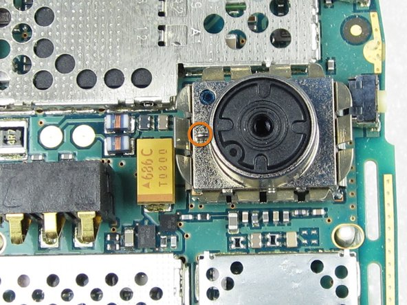 Place the circuit board on a firm, static free surface (no cloth/carpet).