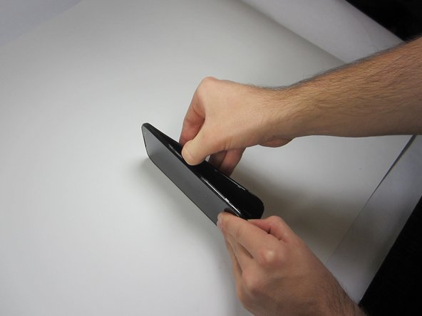 Next, gently slide your thumb (or plastic tool if you prefer) down the seem running the length of your Blu Studio until the rear panel is completely removed.