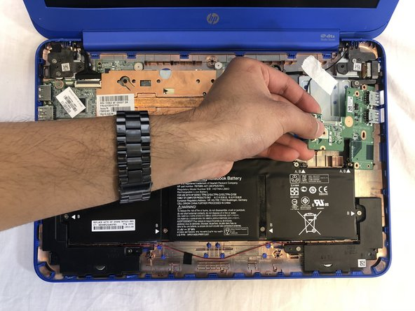 Remove the chip containing the two USB Ports.
