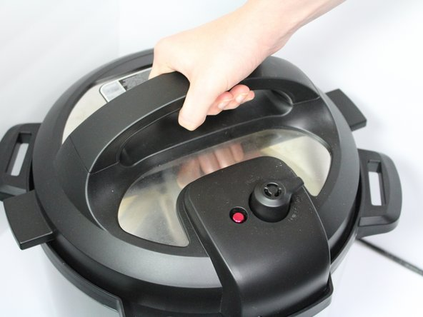 Remove the lid of the Instant Pot by twisting it counter-clockwise.
