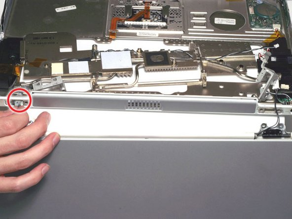 Carefully thread the inverter cable on the right side through the slot in the upper case.
