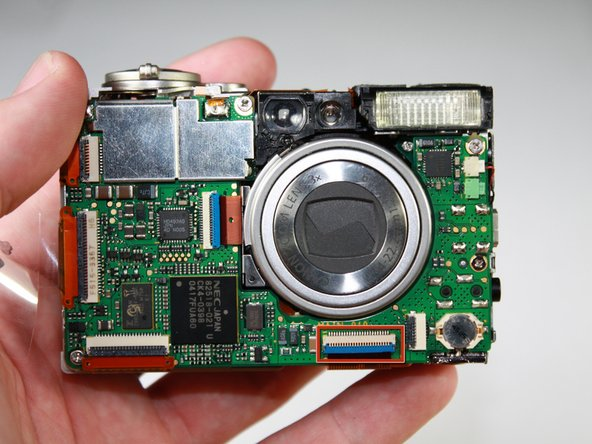 Turn the camera so that the motherboard is facing you.