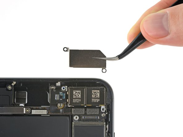 Remove the bracket covering the rear-facing camera.