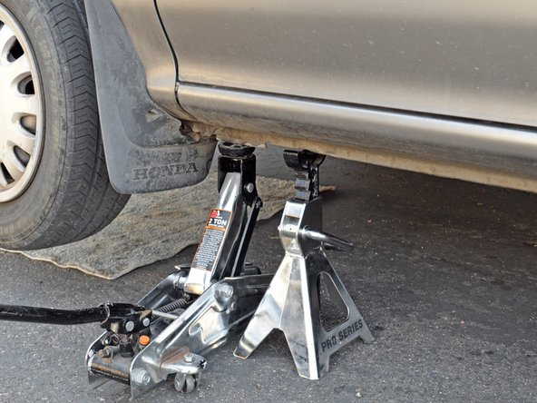 Use the jack to lift the car off of the jack stand.