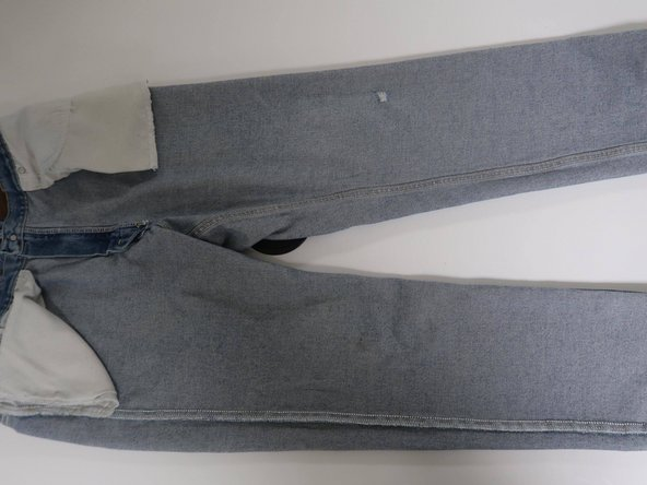 Flip jeans inside out.