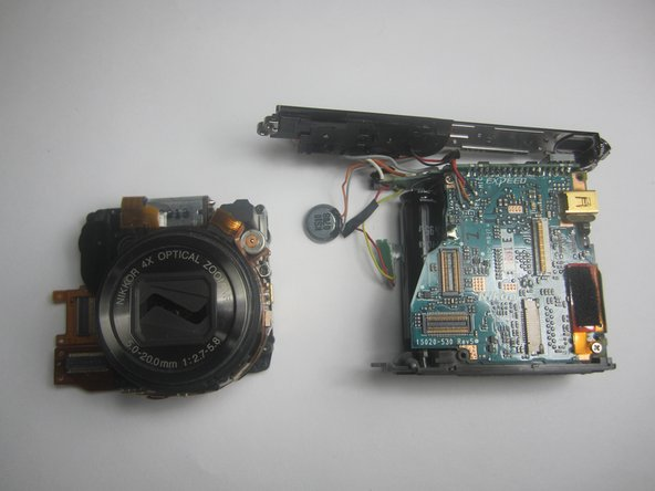 Gently separate the camera lens from the mother board.