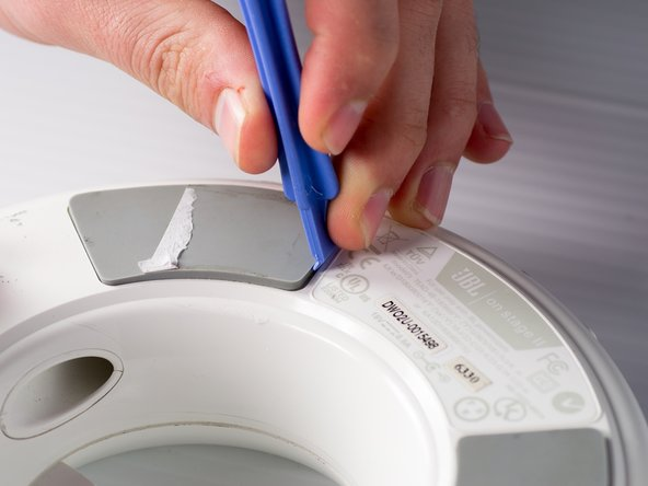 Remove the heated rubber pad with a plastic opening tool.