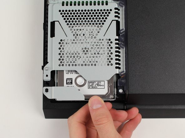 Slide the hard drive forward to remove it.