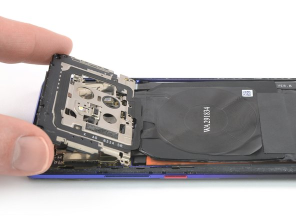 Carefully fold the motherboard cover in the direction of the battery.