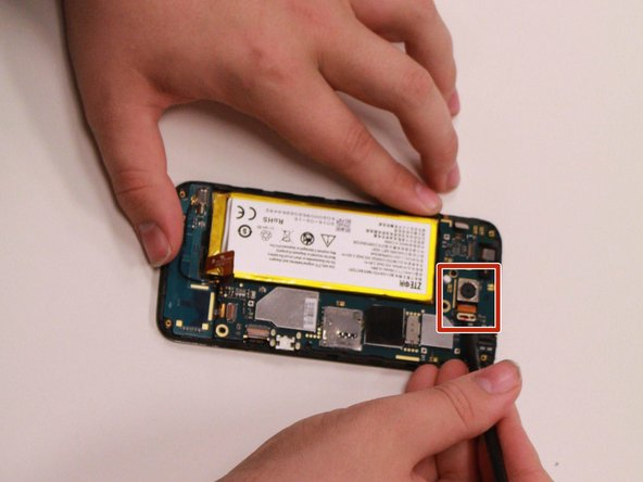 Use a pair of tweezers to carefully detach the ribbon cable connecting the camera to the motherboard.