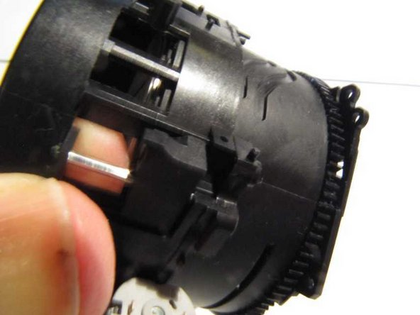 To reassemble, first fit the geared section to the outermost section, ensuring that the pips in the flash head actuator are engaged in the grooves in the geared section.