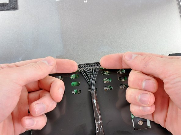 Lift the inverter cable connector straight up from its socket on the inverter board.