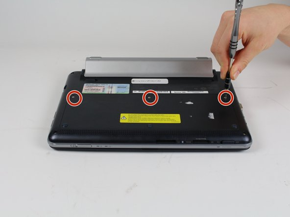 Use a Phillips #0 screwdriver to unscrew the three screws from the HDD panel on the bottom of the laptop.